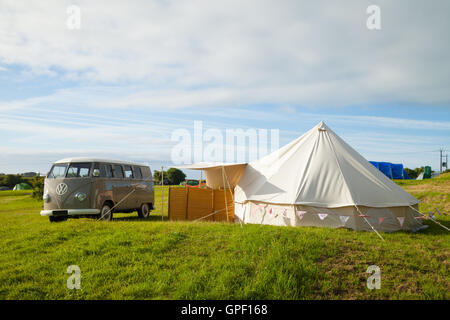 A VW Camper Van and tent in an English campsite. - Stock Photo