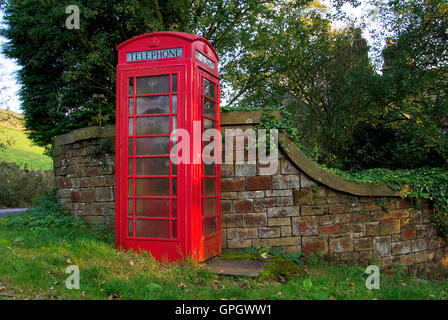 Vintage English Telephone Box in Evening Light - Stock Photo