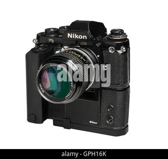 1990 Nikon F3 professional 35mm film camera withMD4 Motordrive and 105 mm lens - Stock Photo