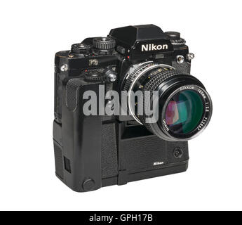 1990 Nikon F3 professional 35mm film camera with MD4 Motordrive and 105 mm lens - Stock Photo