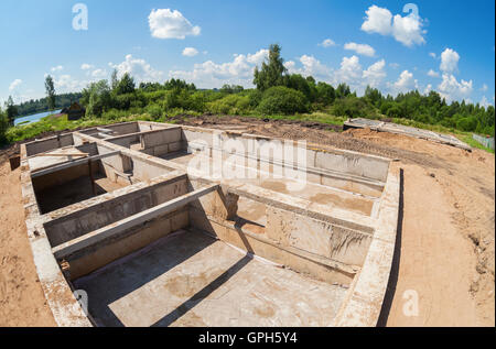 View of construction site and house foundation in preparation process - Stock Photo