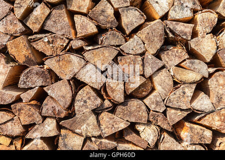 Chopped and stacked up dry firewood as background - Stock Photo