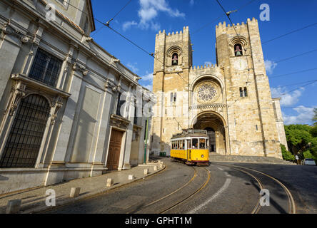 Old tram in front of cathedral in Lisbon, Portugal - Stock Photo