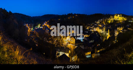 Panoramic view of the beautiful Eifel village Monschau with night blue sky in Germany. - Stock Photo