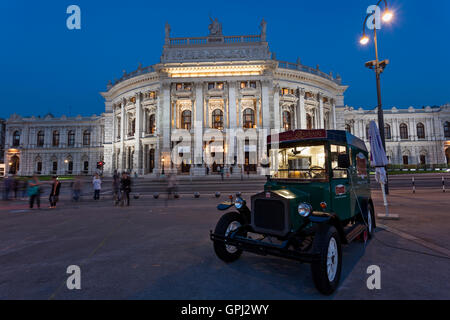 Vintage car in front of Burgtheater in the evening in Vienna, Austria - Stock Photo