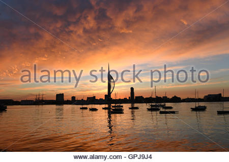 A spectacular sunrise over Portsmouth Harbour and the Emirates Spinnaker Tower in Portsmouth during summer - Stock Photo
