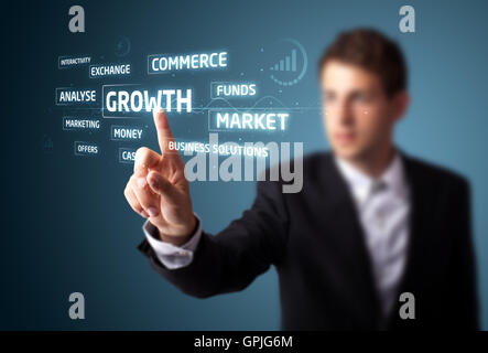 Businessman pressing modern business type of buttons - Stock Photo