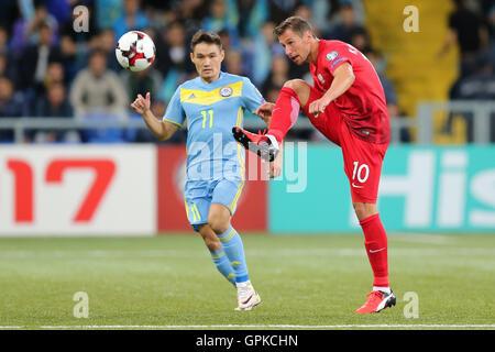 Astana, Kazakhstan. 4th September, 2016. Grzegorz Krychowiak (POL), Serikzhan Muzhikov (KAZ), Kazakhstan versus Poland, FIFA World Cup 2018 qualifier. The game ended in a 2-2 draw Credit:  Action Plus Sports Images/Alamy Live News