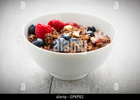 Cereals and flakes with nuts and fresh berries. - Stock Photo