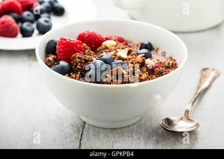 Cereals with dried fruits, nuts and fresh berries. - Stock Photo
