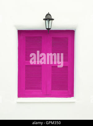 pink Greek Style windows and lamp - Stock Photo