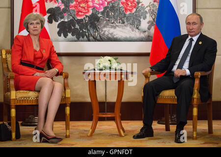Prime Minister Theresa May holds a news conference with Russian President Vladimir Putin before the start of the - Stock Photo