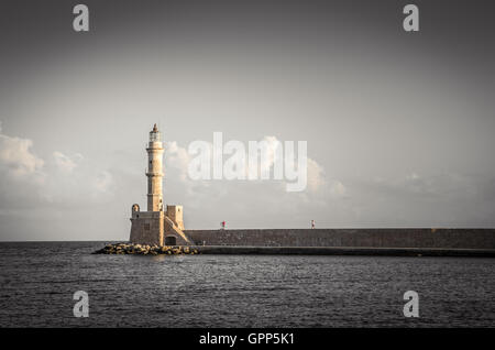 The old lighthouse of Chania at sunset, Crete Island, Greece. View of the old venetian port of Chania on Crete island - Stock Photo