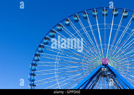 Ferris wheel with blue sky in the background - Stock Photo