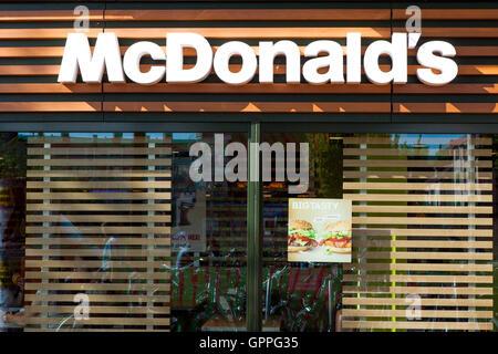 McDonald's sign, McDonald's is the world's largest chain of hamburger fast food restaurants, serving around 68 million - Stock Photo