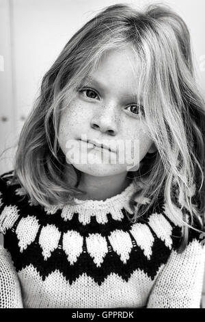 Young girl with a messy hair and wearing a sweater. - Stock Photo