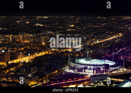 Melbourne, Australia - August 27, 2016: Aerial night view of the city and Melbourne Cricket Ground - home of Australian - Stock Photo