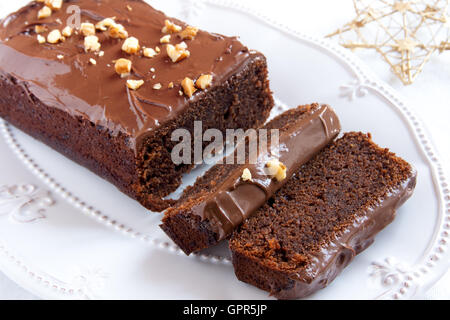 Chocolate cake for Christmas and winter holidays on white oval dish - Stock Photo