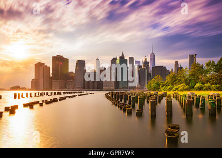 New York City skyline at dusk. - Stock Photo