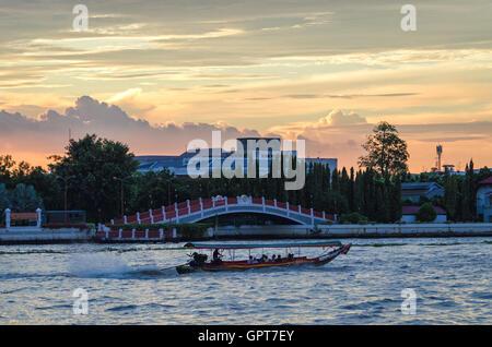 Bangkok scenic view on river Chao Phraya at sunset - Stock Photo