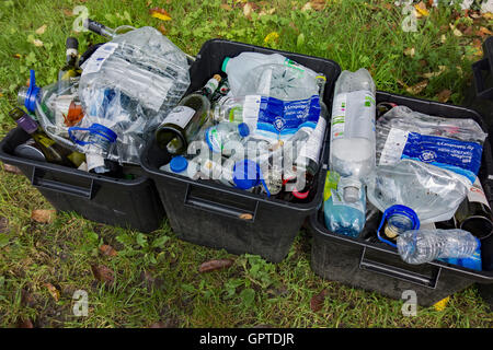 Plastic bottles and glass bottles in waste recycling collection boxes. - Stock Photo