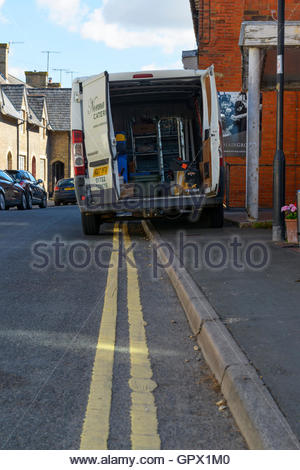 Delivery van parked on double yellow lines, Wilton, Wiltshire, England UK - Stock Photo