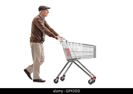 Elderly man pushing a shopping cart isolated on white background - Stock Photo