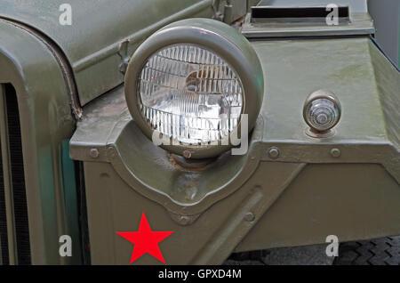 Headlights of an retro military vehicle during World War II - Stock Photo
