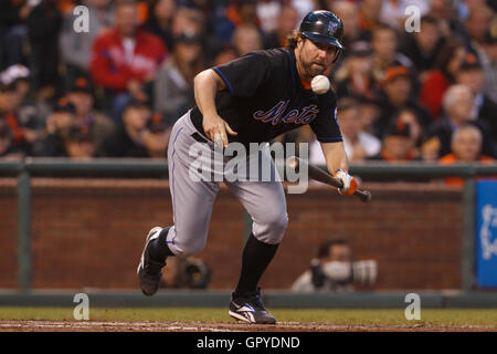 July 8, 2011; San Francisco, CA, USA;  New York Mets starting pitcher R.A. Dickey (43) bunts against the San Francisco - Stock Photo