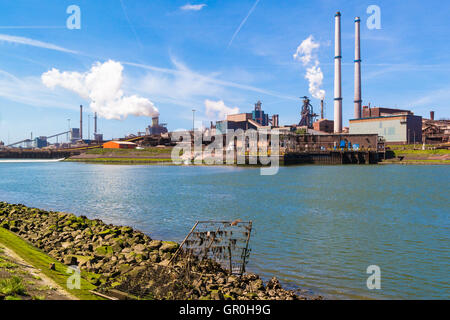 Steel making industry and North Sea Canal in IJmuiden near Amsterdam in Netherlands - Stock Photo