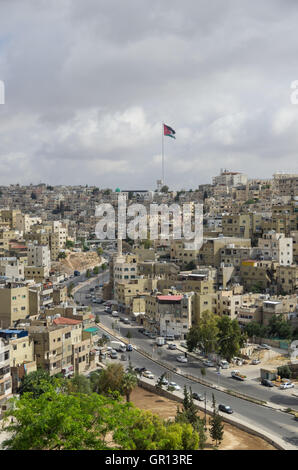 Amman city view with big Jordan flag and flagpole, Amman, Jordan - Stock Photo