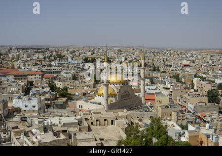 Madaba, Jordan - June 3, 2016: Panoramic view over the town center of Madaba in Jordan with the Central Mosque - Stock Photo
