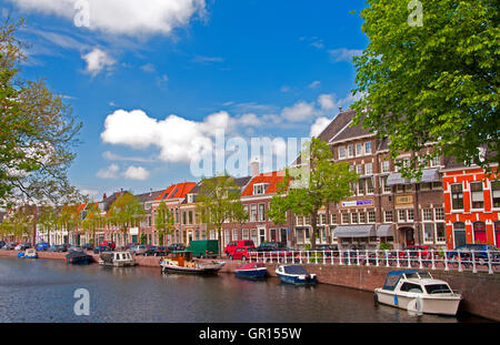 Street scene along a canal in Haarlem, Holland, the Netherlands - Stock Photo
