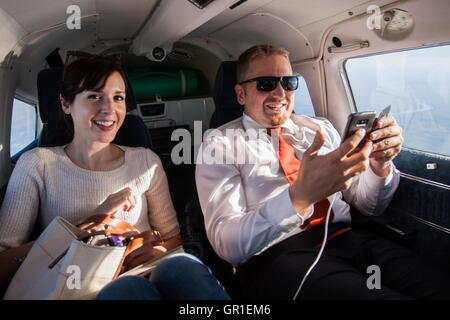 Aug 29, 2016 - Liberland - Journalist Morgan Childs and president of Liberland VIT JEDLICKA in a private plane. - Stock Photo