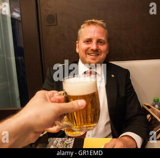 Aug 29, 2016 - Novi Sad, Serbia - Clicking beer glasses with Liberland President VIT JEDLICKA on a train. The Free - Stock Photo
