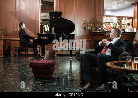 Aug 29, 2016 - Novi Sad, Serbia - President of Liberland VIT JEDLICKA on the right is listening a piano musician - Stock Photo