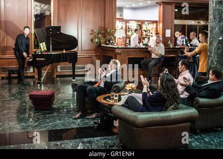 Aug 29, 2016 - Novi Sad, Serbia - President of Liberland VIT JEDLICKA (second left) is listening a piano musician - Stock Photo