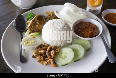 Nasi lemak served in the restaurant, famous Malaysia dish. - Stock Photo