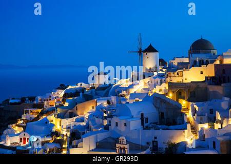 Oia village by night, Santorini, Greece. - Stock Photo