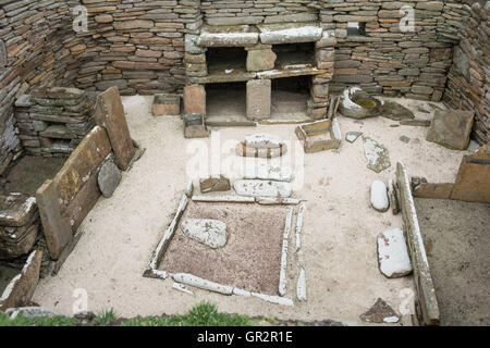Remains of one of the homes at Skara Brae, a stone-built Neolithic village on the west coast of the Orkney Islands - Stock Photo