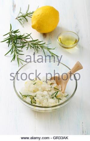 Homemade scrub made of sea salt, lemon peel and lemon juice - Stock Photo