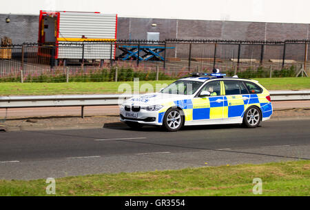 Police Scotland BMW police car speeding in response to an incident along the Kingsway West dual carriageway in Dundee, - Stock Photo