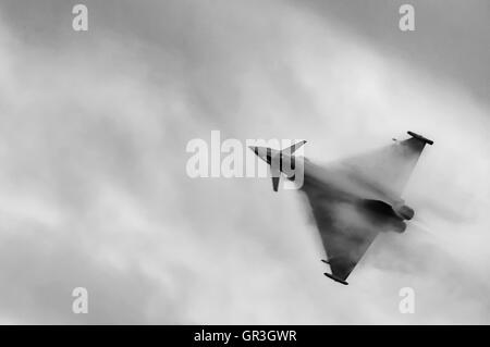 A condensation cloud forms over the wings of a Eurofighter Typhoon from the Royal Air Force - Stock Photo