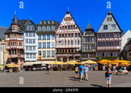 Restored medieval houses on cobblestoned Römerberg square in the  historic centre of Frankfurt, Germany