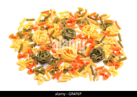 A different pasta in three colors. - Stock Photo