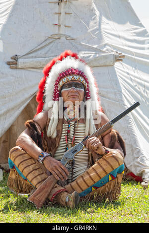 North American Indian in full dress. - Stock Photo
