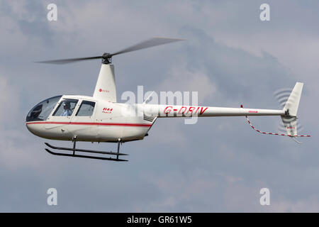 Robinson R44 helicopter G-DRIV - Stock Photo