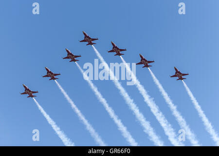 Patrouille Suisse, the formation aerobatics team of the Swiss Air Force flying Northrop F-5E Tiger II Jet aircraft. - Stock Photo