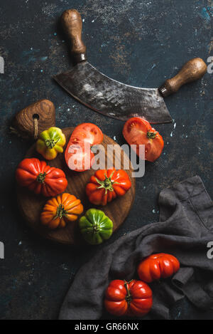Fresh colorful ripe heirloom tomatoes on wooden board - Stock Photo