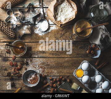 Christmas holiday cooking and baking ingredients on wooden background - Stock Photo